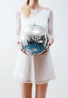 3cd67c533ec405 Woman In White Holding A Shiny Disco Ball