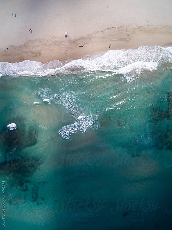 Aerial view of a beach in a cloudy day by Luca Pierro for Stocksy United