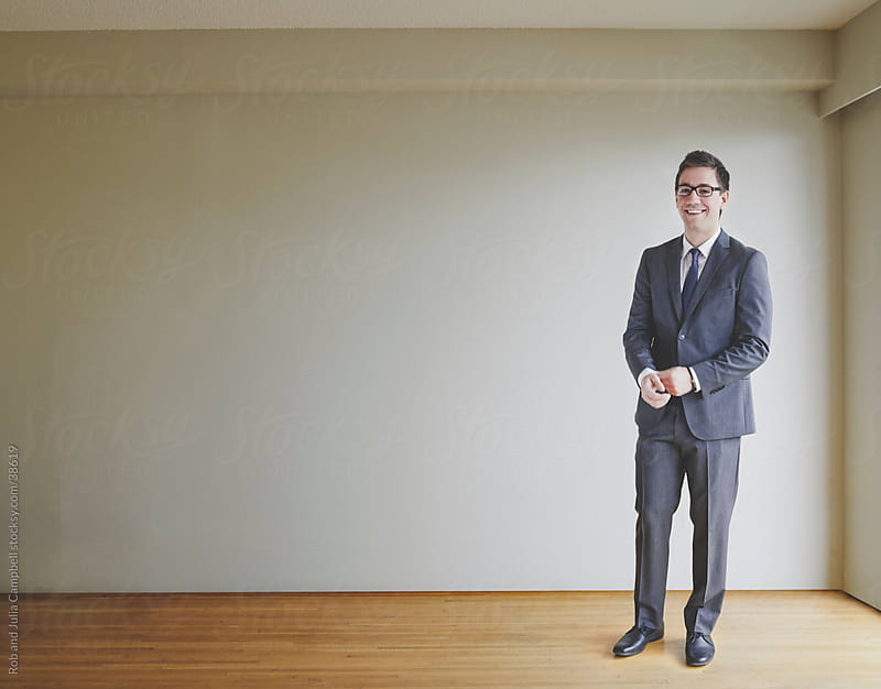 Portrait of Business Man in Suit and Tie by Rob and Julia Campbell for Stocksy United