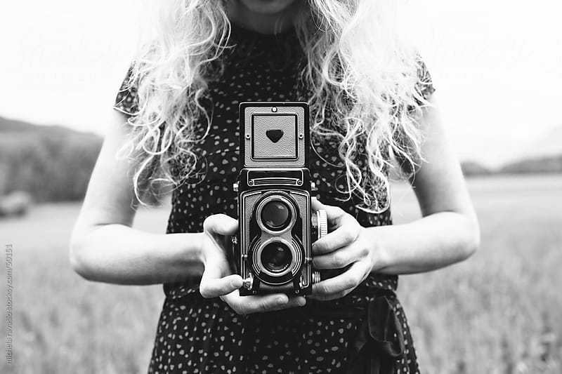 Woman holding vintage camera by michela ravasio for Stocksy United