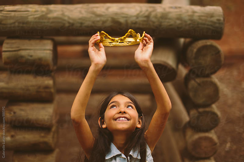 Young Girl Playing With a Crown by Gabrielle Lutze for Stocksy United