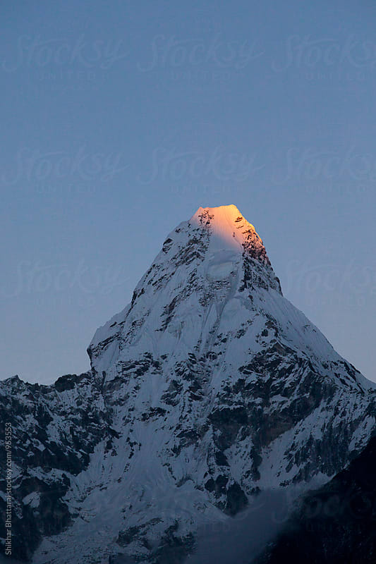 Peak of Mt. Amadablam lit by the last rays of the day. by Shikhar Bhattarai for Stocksy United