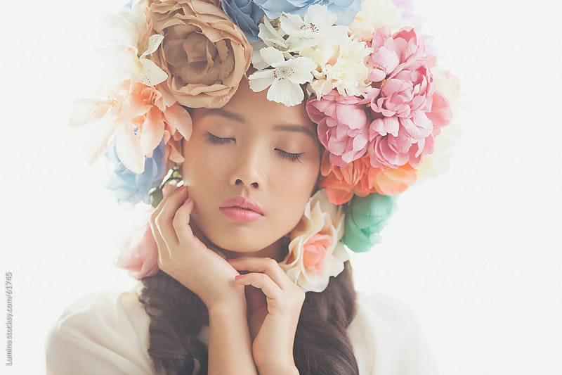 Beautiful Asian Woman With a Flower Wreath  by Lumina for Stocksy United