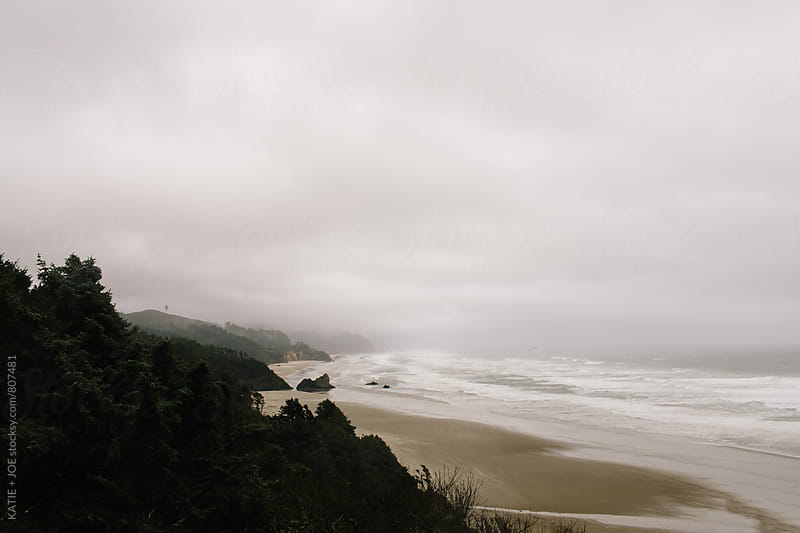 View of the oregon coast on a cloudy day by KATIE + JOE for Stocksy United