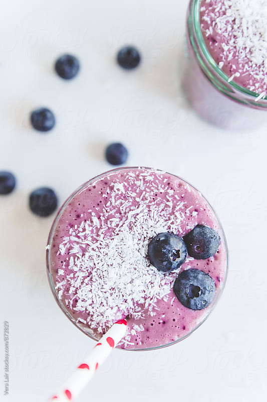 Bilberry smoothie in glasses by Vera Lair for Stocksy United