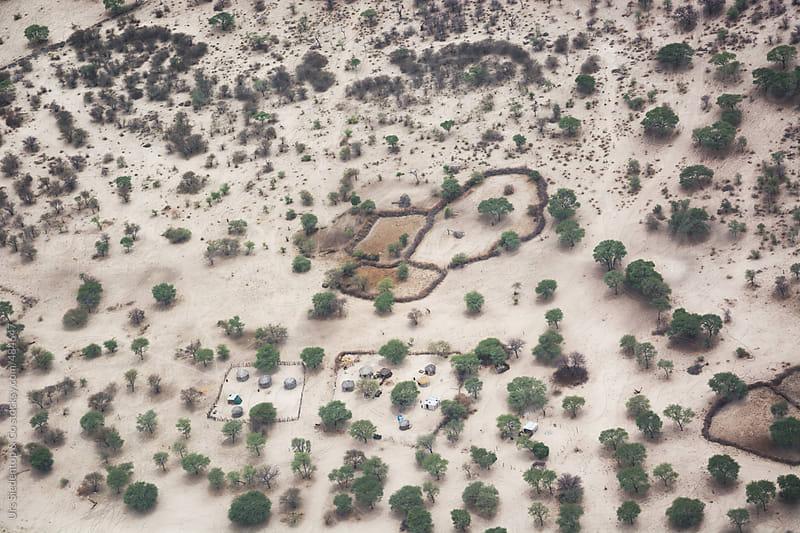 Aerial Shot of small settlement of stock breeders in Botswana by Urs Siedentop & Co for Stocksy United