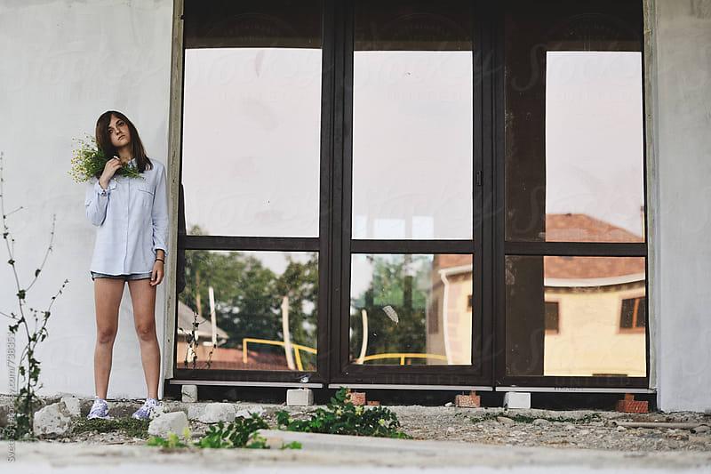 The girl near the house by Sveta SH for Stocksy United