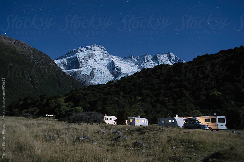 Campervans parked up with Mt Sefton lit up by moon light, Aoraki / Mt Cook National Park, New Zealand. by Thomas Pickard for Stocksy United