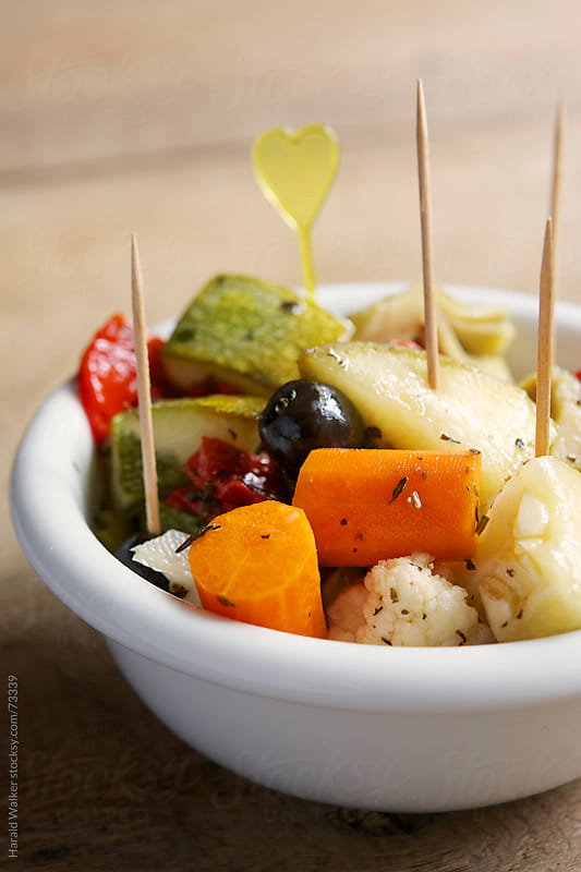 Marinated summer vegetables by Harald Walker for Stocksy United