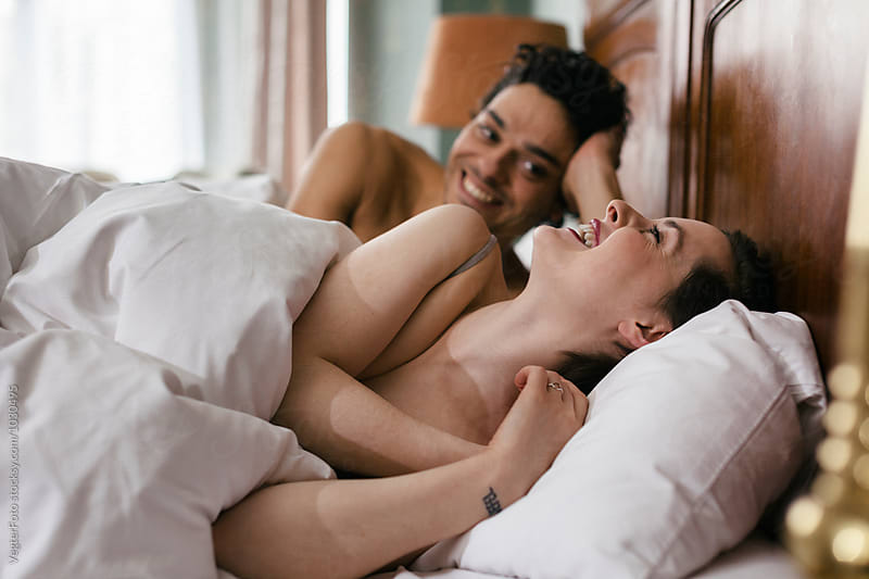 Romantic  Couple in Bed by VegterFoto for Stocksy United