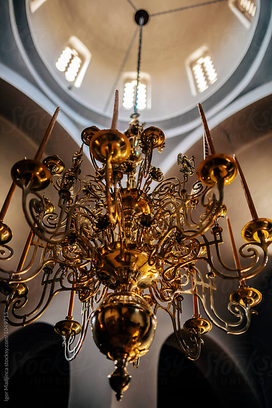 golden chandelier in the orthodox church by Igor Madjinca for Stocksy United