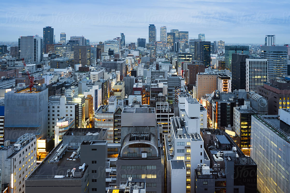high angle view of modern buildings in city against sky,Nagoya, Japan by  Miss Rein - Stocksy United