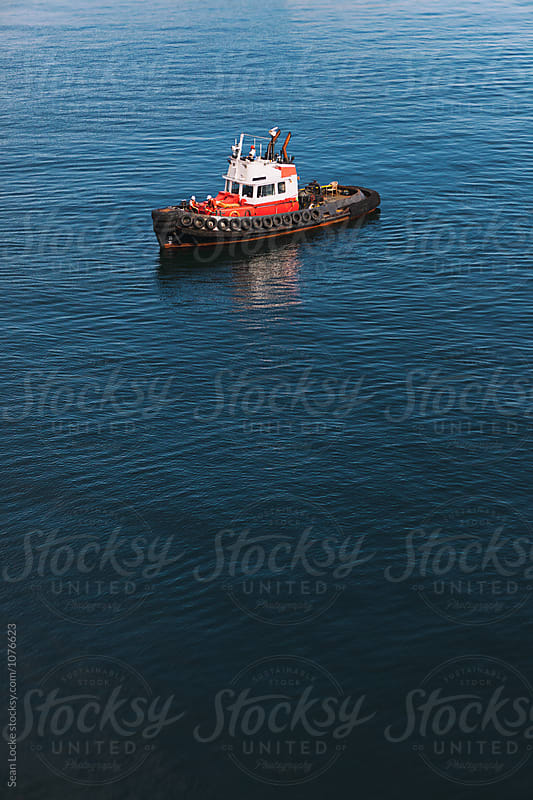 Tugboat Outside Of The Victoria Harbor by Sean Locke for Stocksy United