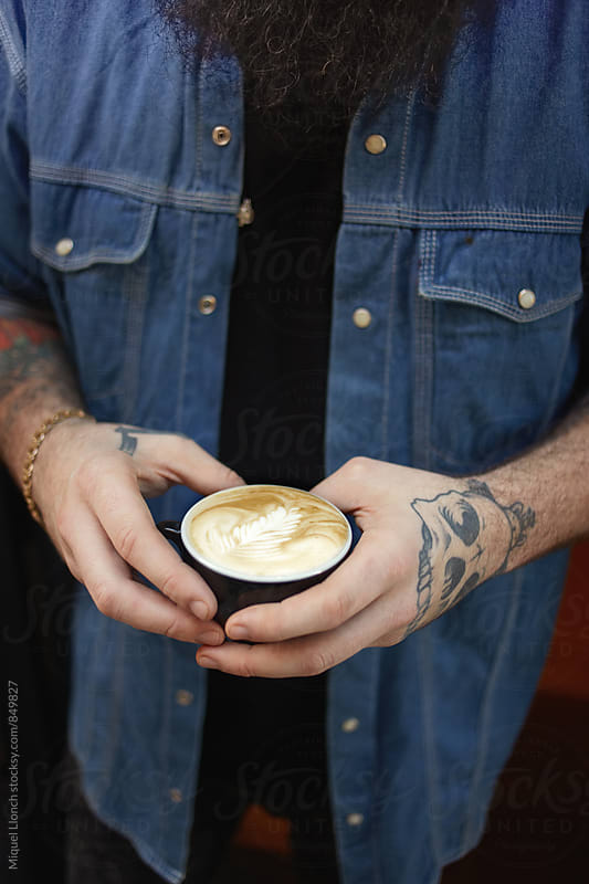 Male tattooed hands holding a beautiful cup of coffee by Miquel Llonch for Stocksy United