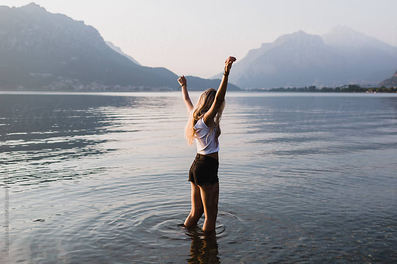 Young beautiful woman enjoying the lake in summertime by michela ravasio for Stocksy United