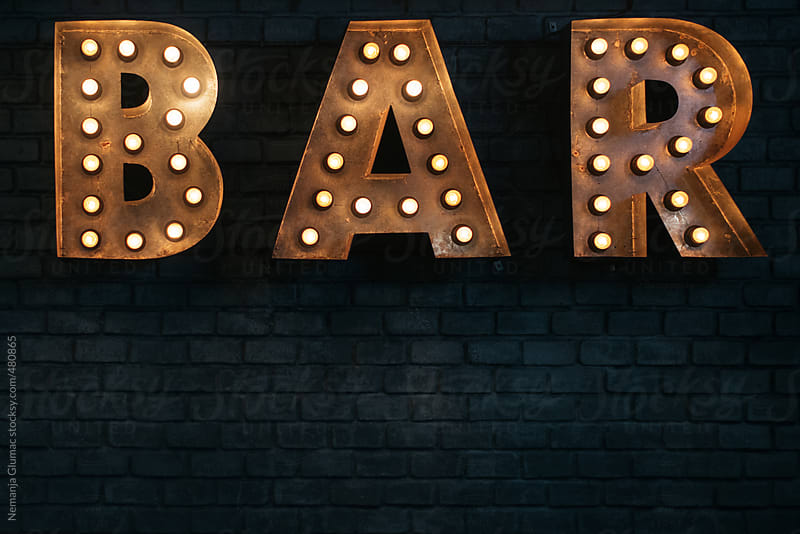 Vintage Industrial Bar Sign Glowing In The Dark By