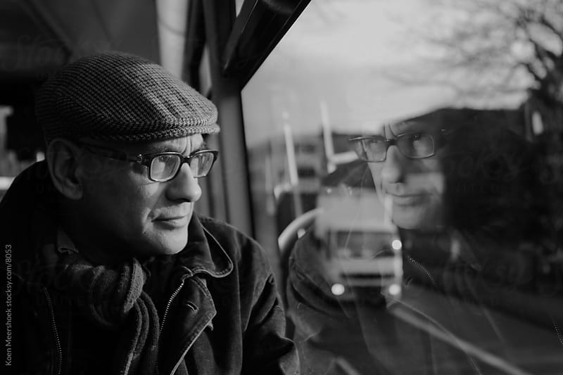 Man dreaming in a bus. by Koen Meershoek for Stocksy United