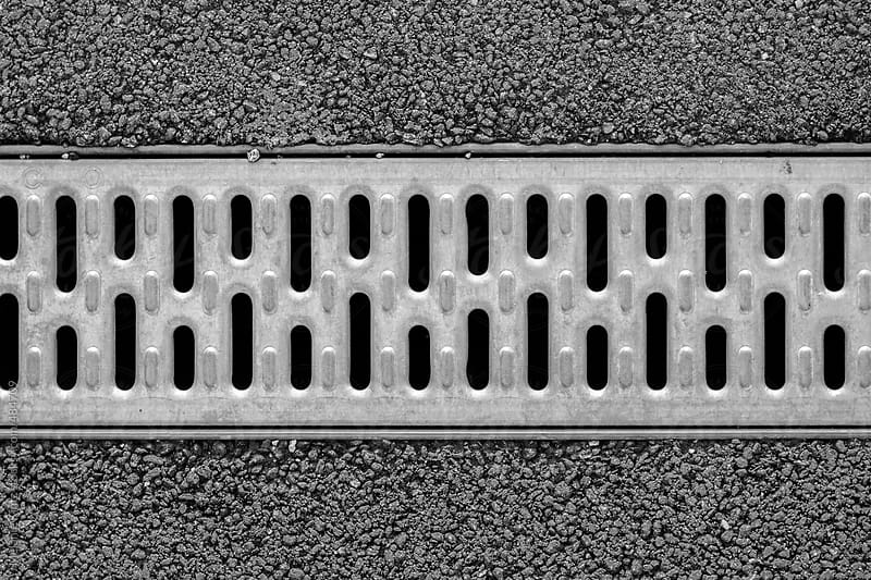 Drainage gutter in pavement by Melanie Kintz for Stocksy United