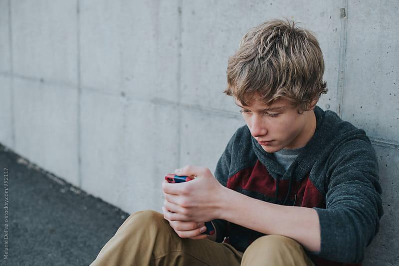Teen boy by Melanie DeFazio for Stocksy United