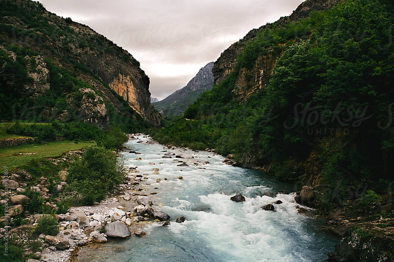 Blue river in a valley by Freek Zonderland for Stocksy United
