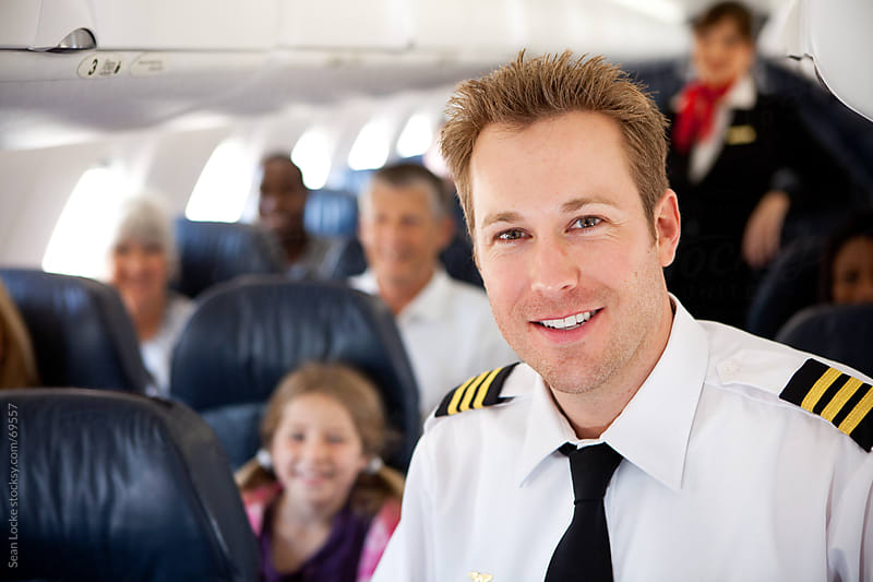 Airplane: First Officer with Passengers Behind by Sean Locke for Stocksy United