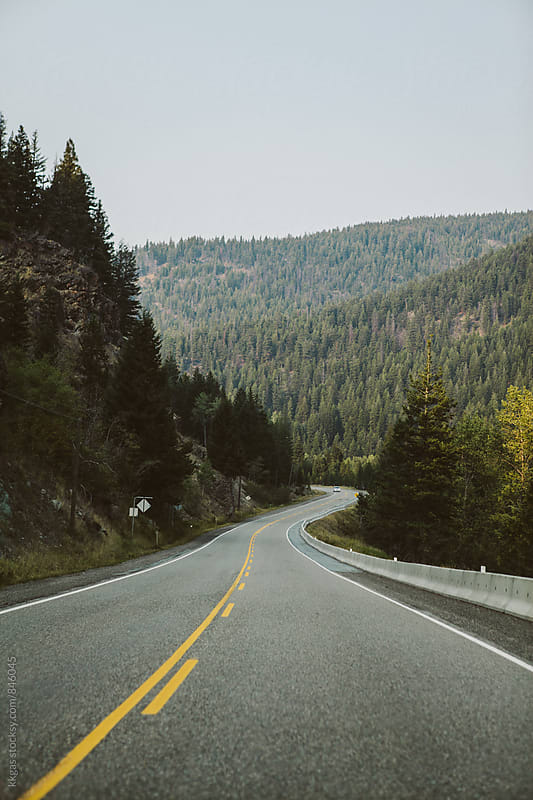 Empty winding highway through Canadian mountains by kkgas for Stocksy United
