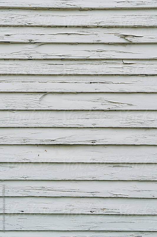 Wood plank wall with cracked white paint by Adam Nixon for Stocksy United