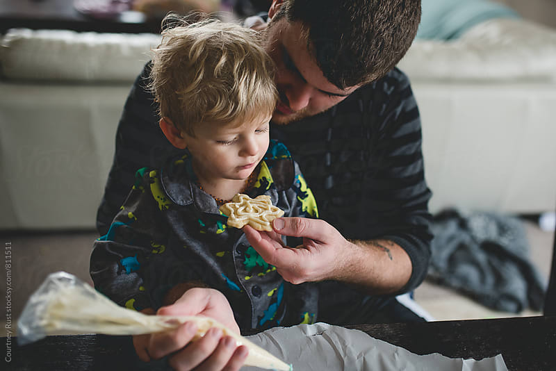 Dad offers a cookie by Courtney Rust for Stocksy United
