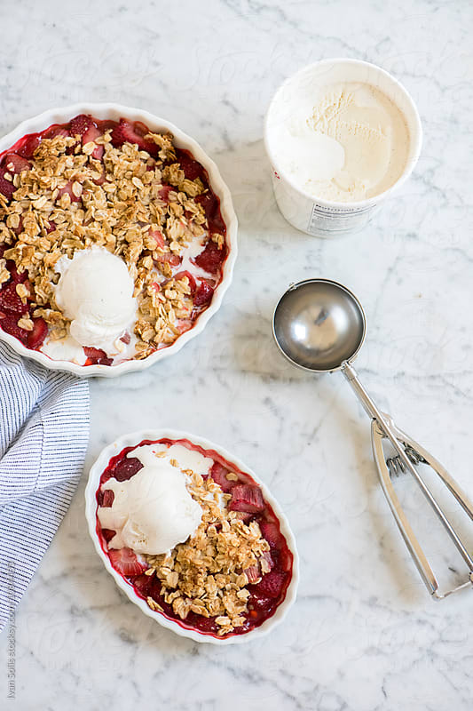 Strawberry rhubarb crumble  by Ivan Solis for Stocksy United