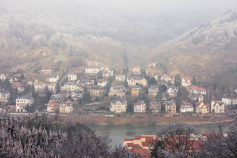 Historic German homes in front of the River Neckar, Heidelberg,  by Holly Clark for Stocksy United