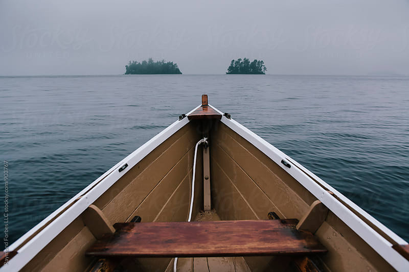 Wooden Boat on Foggy Day by Raymond Forbes LLC for Stocksy United