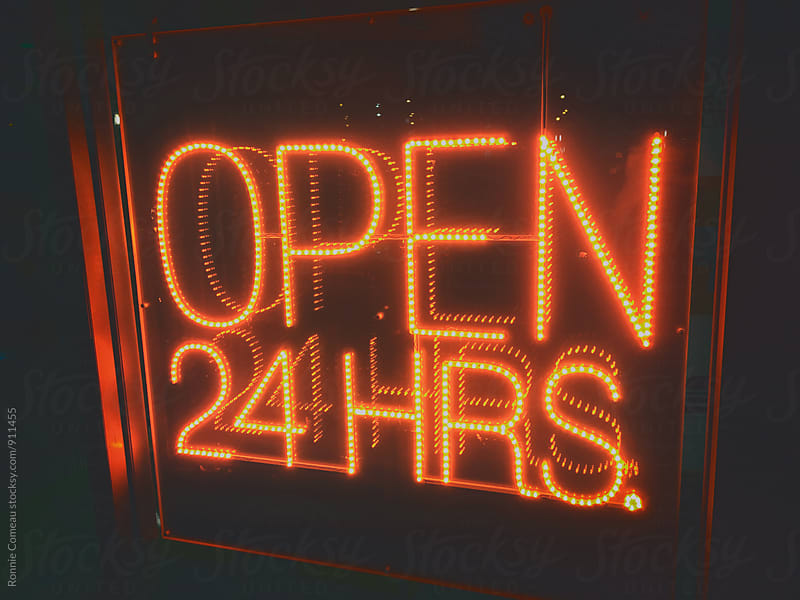 Open 24 Hours Sign by Ronnie Comeau for Stocksy United
