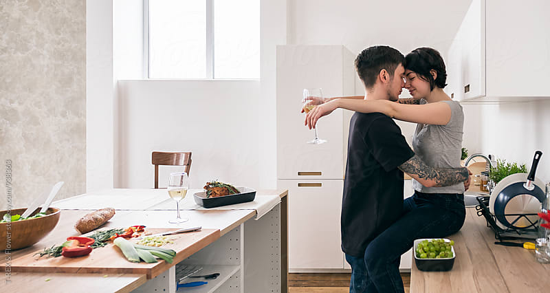 Young couple hugging in modern kitchen by Danil Nevsky for Stocksy United