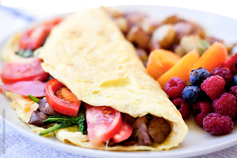 Stuffed omelette with side dish by Lior + Lone for Stocksy United
