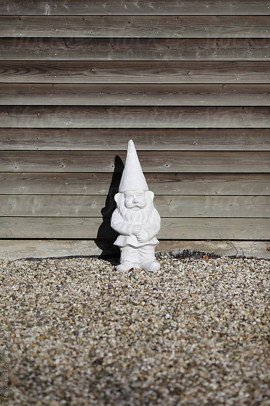 Gnome in front of a house by Marcel for Stocksy United