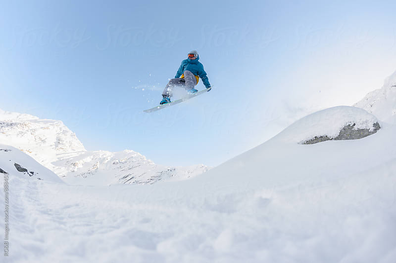 Snowboarder jumping  by RG&B Images for Stocksy United