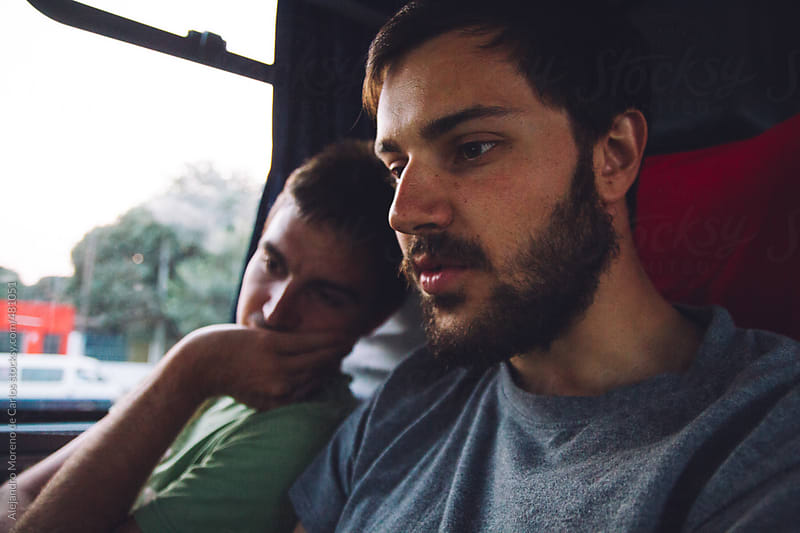 Two friends traveling on a bus at sunset by Alejandro Moreno de Carlos for Stocksy United