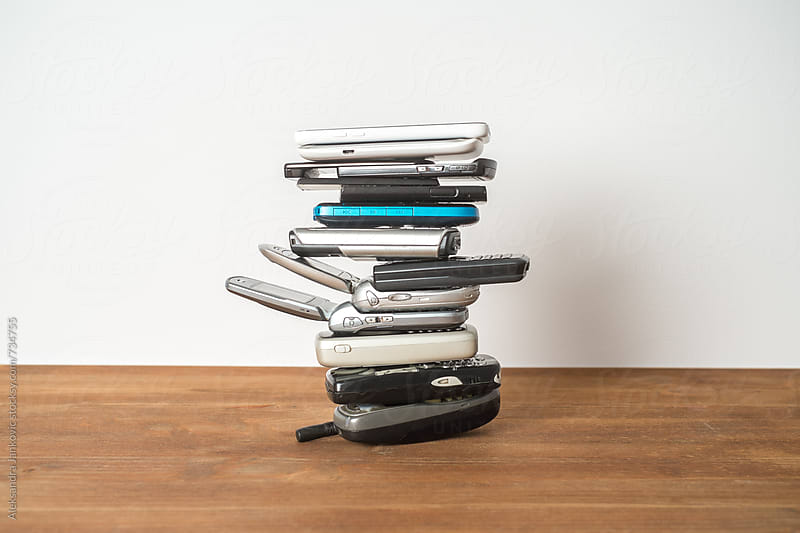 Stacked Mobile Phones in Front of the White Background by Aleksandra Jankovic for Stocksy United