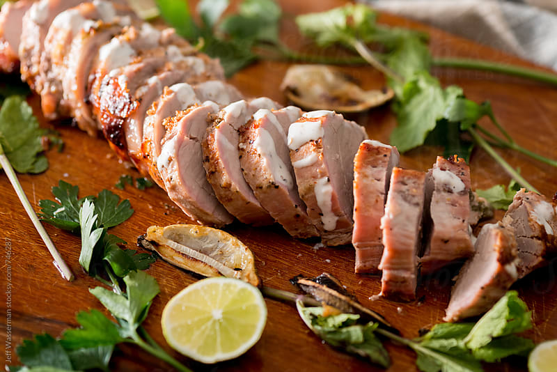 Sliced Cooked Marinated Pork Tenderloin by Jeff Wasserman for Stocksy United