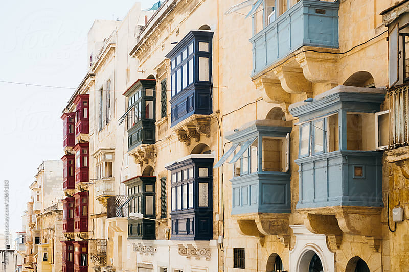 Maltese Buildings with colourful balconies by Sam Burton for Stocksy United