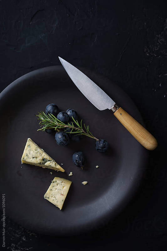 Cheese and grapes. by Darren Muir for Stocksy United