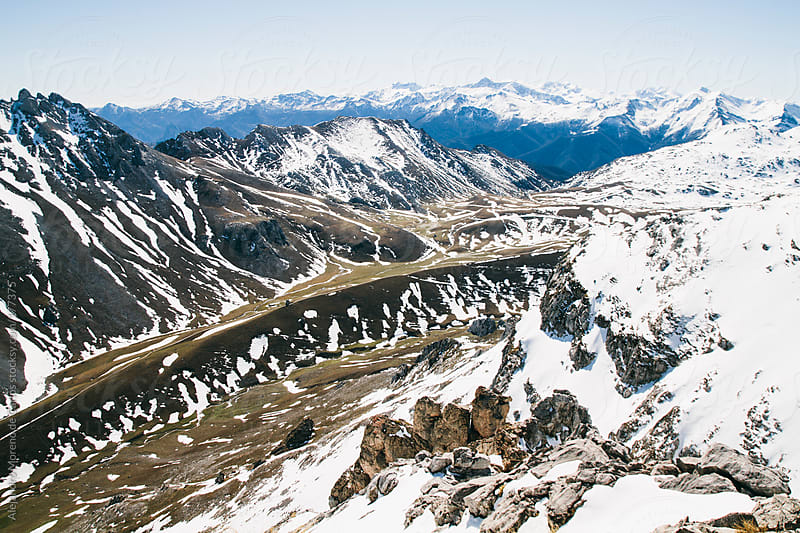 Snow mountain landscape in spring by Alejandro Moreno de Carlos for Stocksy United
