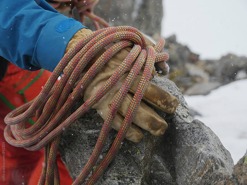 Hand with alpinist's rope on rock by rolfo for Stocksy United