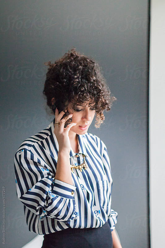 Young modern woman having a phone call. by Audrey Shtecinjo for Stocksy United