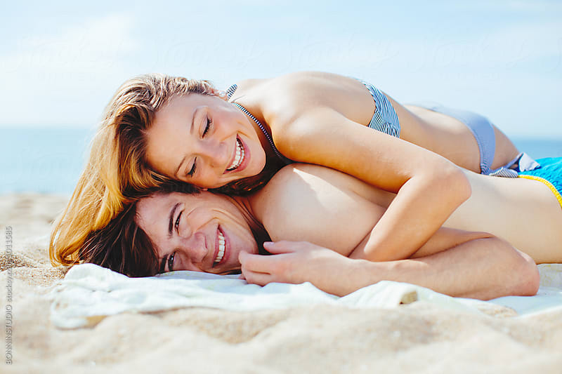 Closeup portrait of a teenage couple having fun together on the beach in summer.  by BONNINSTUDIO for Stocksy United