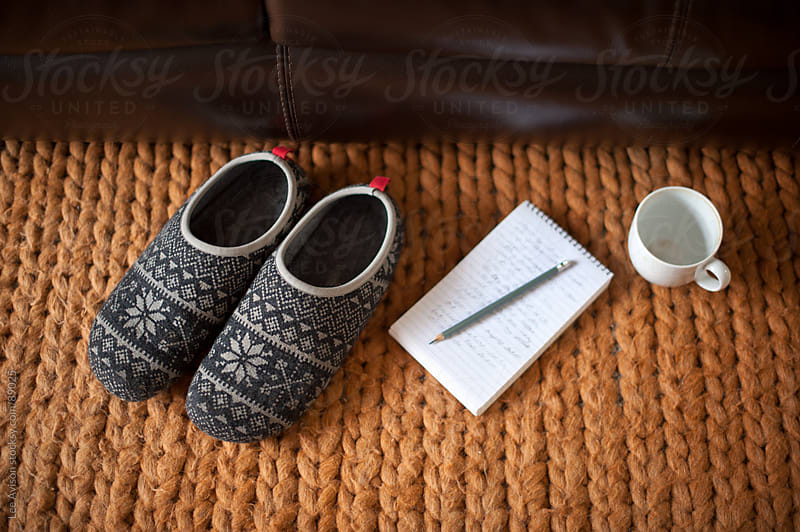 slippers, notepad and pencil and empty cup by Lee Avison for Stocksy United