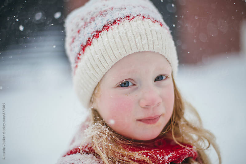 Portrait of A Little Girl in a Blizzard by Amanda Voelker for Stocksy United