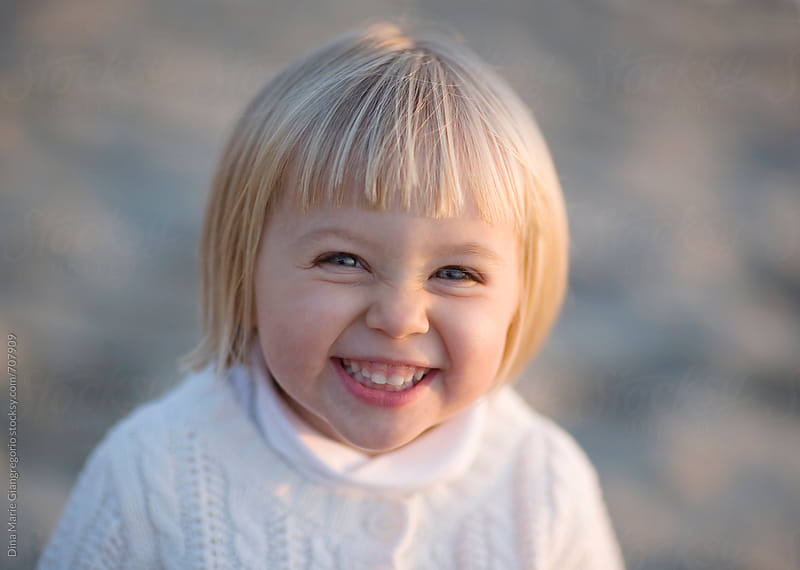 Blonde Girl With Pixie Haircut Giggling by Dina Giangregorio for Stocksy United