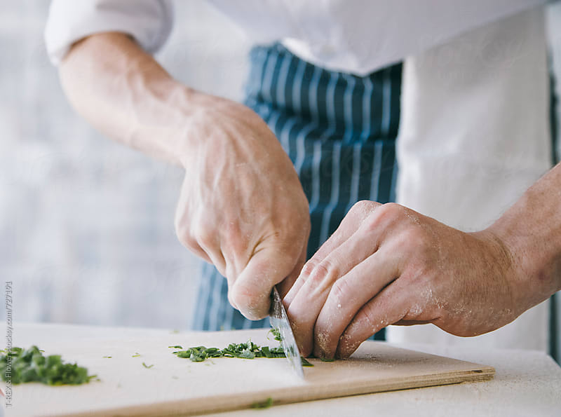 Close up of chef chopping greenery  by Danil Nevsky for Stocksy United