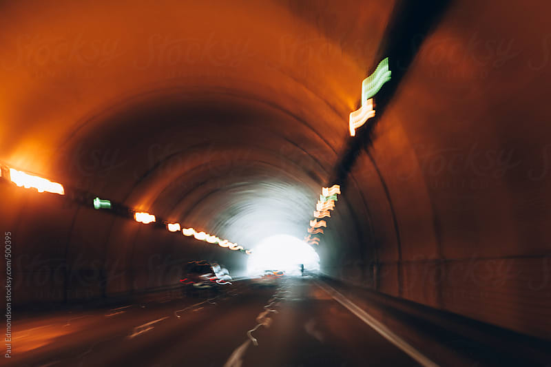 Cars driving through tunnel, blurred motion by Paul Edmondson for Stocksy United